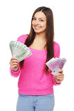 Casual woman with us dollars abd euro cash. Happy young woman in bright pink sweater holding us dollar money in one hand and euro cash money in another hand Stock Images