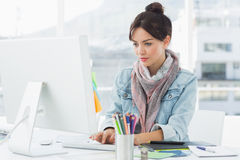 Casual woman using computer in office Stock Images