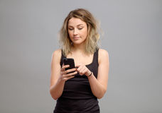 Casual woman using her smartphone Stock Photo