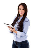 Casual woman using a tablet Royalty Free Stock Photography