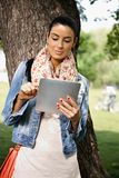 Casual Woman Using Tablet PC Outdoors Royalty Free Stock Image
