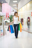 Casual woman walking with shopping bags Royalty Free Stock Photo