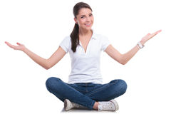 Casual woman welcoming seated Royalty Free Stock Photo