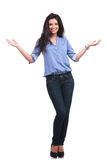Casual woman welcoming you with a smile. Full length portrait of a young casual woman welcoming you with a smile on her face. on white background Stock Photo