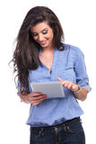 Casual woman working on a tablet Royalty Free Stock Image