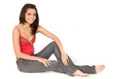 Casual Women. An attractive young woman posing casually in a studio Stock Photos