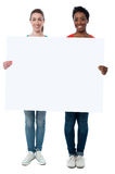 Casual women holding blank whiteboard Royalty Free Stock Photos
