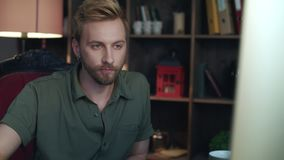 Casual worker face looking computer in office. Hipster man working in studio stock footage