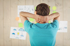 Casual worker looking at brainstorm wall Royalty Free Stock Images