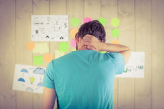 Casual worker looking at brainstorm wall Royalty Free Stock Photos