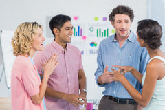 Casual workers communicating and interacting Stock Images