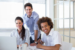 Casual workers smiling to camera Stock Image