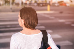 Casual young adult woman walking on city streets Royalty Free Stock Photography
