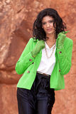 Casual young biracial woman with jacket and gloves Royalty Free Stock Photos