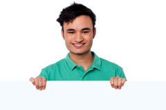 Casual young boy holding blank whiteboard Stock Photos