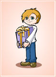 Casual young boy standing with gift box Stock Images