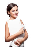 Casual young brunette girl holding sign Royalty Free Stock Photography