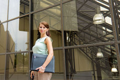 Casual young business woman in downtown urban scene Royalty Free Stock Photography
