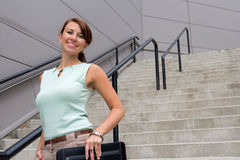 Casual young business woman in downtown urban scene Royalty Free Stock Photo