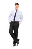 Casual young businessman leaning against a wall Stock Photo