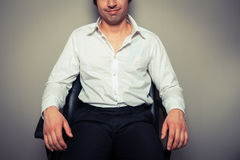 Casual young businessman in office chair Stock Photo