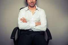 Casual young businessman in office chair Royalty Free Stock Images