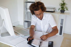 Casual young businessman organizing his schedule at his desk Stock Photo