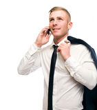 Casual young businessman talking on cellphone. Stock Photos