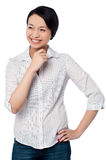 Casual young chinese girl looking away Stock Photo