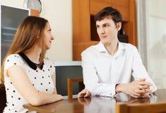 Casual young couple having serious talking Stock Photos