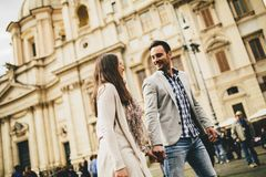 Casual young couple holding hands walking in Rome, Italy, Europe.  stock images