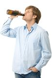 Casual young drinking beer Stock Photo