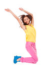 Casual young excited woman  jumping in air Royalty Free Stock Photography
