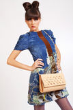 Casual young fashion holding bag Royalty Free Stock Image