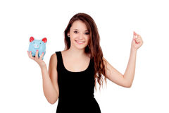 Casual young girl with a blue moneybox Stock Photos