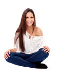 Casual young girl with brackets sitting on the floor Royalty Free Stock Images