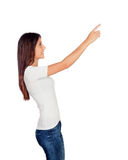 Casual young girl pointing something at side Stock Photos