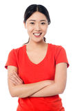 Casual young girl posing, arms crossed Royalty Free Stock Images