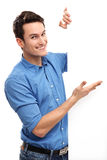 Casual young guy with blank board Royalty Free Stock Photo