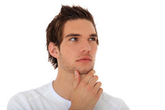 Casual young guy deliberates a decision Stock Photography