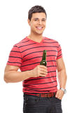 Casual young guy drinking beer Royalty Free Stock Photography