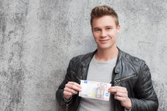 Casual young guy holding 50 euro Royalty Free Stock Images