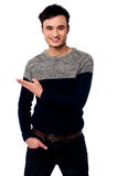 Casual young guy pointing away Stock Photo