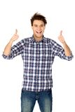 Casual young guy showing thumbs up Stock Images