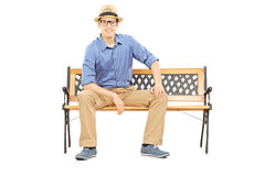 Casual young guy sitting on bench Royalty Free Stock Photo