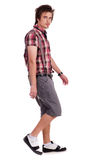 Casual young guy in walking posture Stock Photo