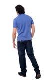 Casual young guy walking in studio stock photos