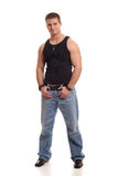 Casual Young Man. In black undershirt and jeans Royalty Free Stock Photo