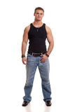 Casual Young Man. In black undershirt and jeans Royalty Free Stock Photos
