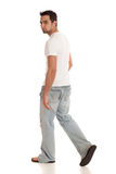 Casual Young Man. In jeans and t-shirt. Studio shot over white Royalty Free Stock Images